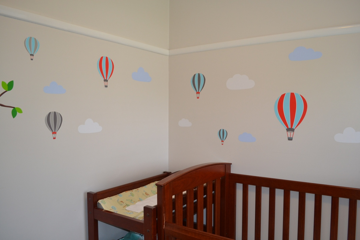 - Evie's skyline of hot-air balloon wall stickers. She's started pulling them down -